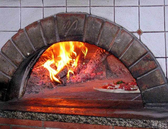 True Neapolitan pizza is cooked in a wood fired oven with perfect hydration dough
