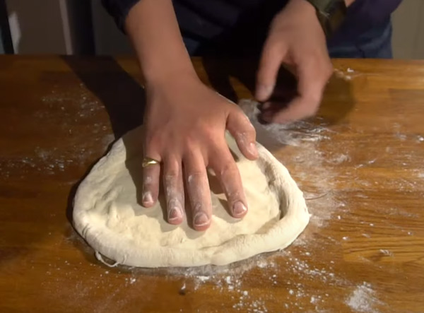 Neapolitan pizza slapping technique