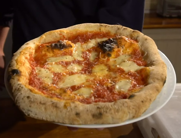 Shaped and stretched Neapolitan pizza