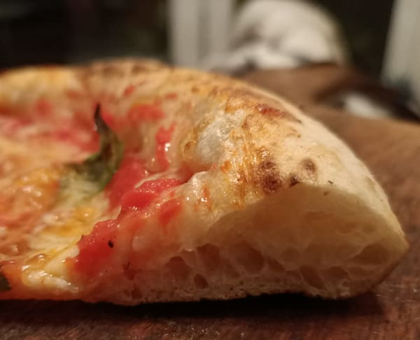 Should you knock back pizza dough?